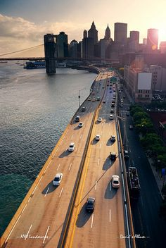Busy traffic in New York City Manhattan with Brooklyn Bridge across Hudson River at sunset. | Songquan Deng  via Flickr