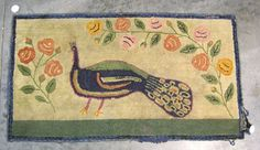 """Estimated: $1500 - $2000 Realized Price: $5850 Vibrant Pennsylvania hooked rug, 19th c., with peacock and flowering vines, 48"""" x 27"""", together with a floral hooked rug with heart corners, 19 1/2"""" x 39"""". Provenance: Peacock - Mabel Renner 1941; Floral - Mary Thornton 1958."""