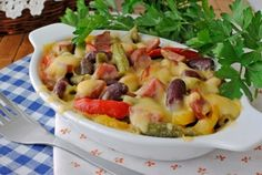 This casserole is the perfect option if you happen to have leftover ham on your hands! Enjoy sautéed and flavorful vegetables along with bites of ham all under a gooey cheese topping. Three Beans, Ham And Beans, Ham Casserole, Vegetable Casserole, Vegetable Medley, Kidney Beans, Pork Recipes, Beans Recipes, Healthy Recipes