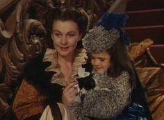 Bonnie Blue (Cammie King Conlon) is thrilled with the kitten her father, Rhett Butler, has given her, but Scarlet O'Hara (Vivien Leigh) would just like a little warmth in the classic film Gone with the Wind (1939).