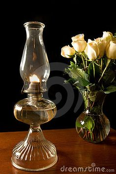 Oil lamp, with roses by Ejwhite, via Dreamstime