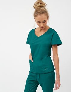The Dolman Top in Hunter Green is a contemporary addition to women's medical scrub outfits. ShopJaanuufor scrubs, lab coats and other medical apparel.