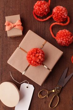 This is my second project for Julep — a pom pom garland made from extra thick wool yarn. I love using pom pom makers for these, but f. Present Wrapping, Creative Gift Wrapping, Creative Gifts, Pretty Packaging, Gift Packaging, Gift Wraping, Brown Paper Packages, Pom Pom Garland, Christmas Gift Wrapping