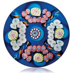 Extremely rare antique Saint Louis patterned millefiori on color ground paperweight.