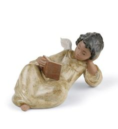 Lladró reading angel! http://www.lladro.com/figurines