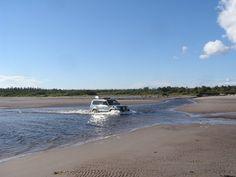 Toyotal Land Cruiser crossing estuary on White Sea