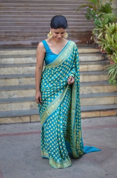 Saree -Banarasi kadhwa Jari Georgette sari with running blouse. Length (with running blouse) Care -Dry wash Discription -colour as shown in the picture may vary from the actual sari image because of process of light and photography Kanakavalli Sarees, Georgette Sarees, Indian Sarees, Saris, Drape Sarees, Silk Sarees, Online Shopping Sarees, Saree Shopping, Sarees Online