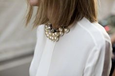 white blouse, statement necklace