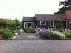 Planted front yard and parking strip Garage To Living Space, Living Spaces, Converted Garage, Front Yard Design, Driveway Landscaping, Construction Cost, Garage Makeover, Space Photos, Outside Living