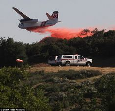 Aerial assault: A plane drops fire retardant in the Banning Bench area of Riverside county. Six helicopters and six air tankers were also ma...