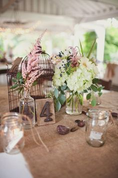 I love the table numbers.. like address numbers for home, just on a wood block? rustic. add a little light blue or light grey and it'd be super chic