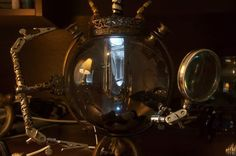 awesome steampunk fishbowl- with glowing crystal in the middle...