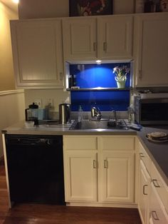 DIY Kitchen backsplash/painted tempered glass. Small under counter light from Home Depot .... $10.00 for 3