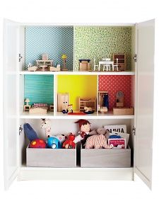 Adorable DIY dollhouse from an IKEA Billy bookcase, small bins, and pretty papers. Love this!