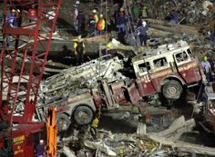 Work crews lift a fire truck from the debris of the collapsed World Trade Center in this Sept. 2001 file photo, in New York. We Will Never Forget, Lest We Forget, World Trade Center, Trade Centre, Flatiron Building, Ambulance, Illuminati, 11 September 2001, See Images