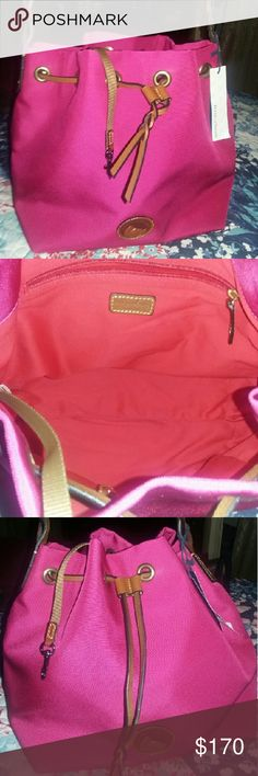 Dooney and Bourke Drawstring style dooney snd Bourke.  New with tag. Prety pink color. Had a zipper compartment inside. Leather braid style strap. Dooney & Bourke Bags Totes