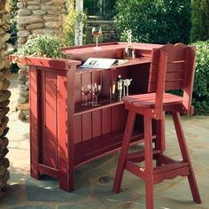 """Pine outdoor barstool in red.   Product: BarstoolConstruction Material: WoodColor: RedFeatures: Suitable for residential or commercial useDimensions: 48"""" H x 18"""" W x 19.5"""" D  Note:  Bar is not included"""