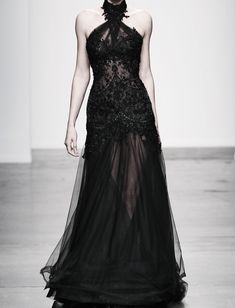 Steven Khalil sheer black dress with elegant beadwork. The dramatic collar makes the look. 2014.