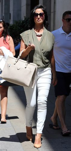 olive green silk top and tight white jeans