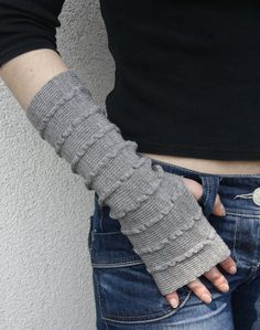 Arm Warmers Bracelets Grey by deliriumkredens on Etsy, $21.00. Darling and handknitted, and in the fabulous gray color that is everywhere. Dig these!