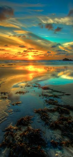 Sunset and calm seas at the breakwater in Bude, north Cornwall, England • photo: mike_pratt