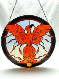 A personal favorite from my Etsy shop https://www.etsy.com/listing/570799658/large-phoenix-rising-stained-glass #StainedGlassLight