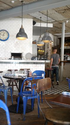 Would love to turn this into a home kitchen: tile, chairs, clock... Love it all! Taken at Pizza East Portobello, London