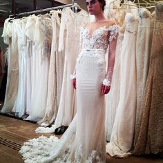 With its 3D blooms on the illusion sleeves, this gown by Inbal Dror is a true floral fantasy
