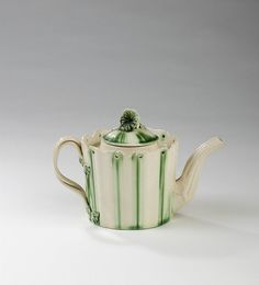 ENGLISH CREAMWARE TEAPOT AND COVER, PROBABLY LEEDS POTTERY, CIRCA 1775. sold $600 2011