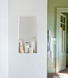 Shampoo is kept in a convenient shower niche. American Olean subway tile.   - HouseBeautiful.com