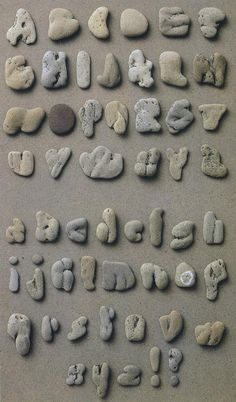 Found pebble alphabet by Clotilde Olyff