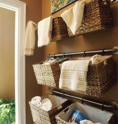 Baskets zip-tied to the towel rack.  This might be the answer to my prayers!