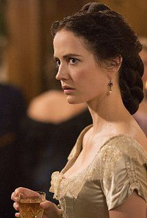 Vanessa Ives dressed in a delicate victorian gown