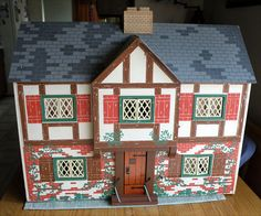 This is a vintage doll house made by Keystone in 1947. It even has electric lights in the rooms!