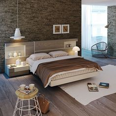Dormitorio de matrimonio moderno con pared de piedra.