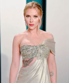 Scarlett Johansson& Oscars After-Party Dress Reveals Her Mysterious Rib Tattoo+ Robert Evans, Chris Evans, Kirsten Dunst, Natalie Portman, Chris Hemsworth, Scarlett Johansson Tattoos, Lady Gaga, Beyonce, Taylor Swift