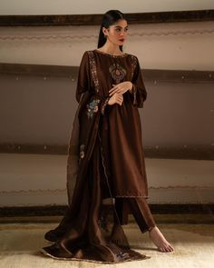 This Dark Brown Silk Straight Pant Suit which will make all the goddesses of love and beauty to write you for your advice. This Boat neck and Full Sleeves dress embroidered with resham, zari and stone work. Pakistani Fashion Casual, Pakistani Dresses Casual, Pakistani Wedding Outfits, Pakistani Dress Design, Indian Dresses, Indian Outfits, Indian Fashion, Dark Fashion, Pakistani Clothing