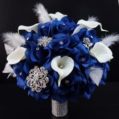 Bouquet is made of open roses in royal blue and Real Touch Calla lily as pictured. Accents with feather and beautiful brooches. Handle isåÊfull bling wrapped decorated with ribbon bow. Bouquet measure More
