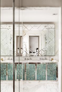 In the bathroom, the Nacre marquetry in Carrera white marble bathroom was designed by Francis Sultana. The ceramic gueridon is by Garouste & Bonetti. Photo: Manolo Yllera
