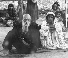 Gypsy couple sitting in an open area in the Belzec concentration camp.jpg (391×336)