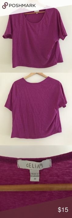 Delia's Crop Top Purple crop top in great condition.  Falls great loose fit and true to size. Tops Crop Tops