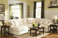 """The Kinning 3-Piece Sectional from Ashley Furniture HomeStore (AFHS.com). With the casual contemporary slipcover look along with the light twill fabric, The """"Kinning-Linen"""" upholstery collection features large rolled set-back arms and supportive boxed cushions that add comfort to the relaxed airy design this furniture brings to any home's décor."""