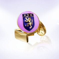 Fun cufflink idea for Easter. Gold and purple lion crest by Skultuna.   #skultuna #cufflinks #cufflink #easter #lion #menswear #MensFashion #style