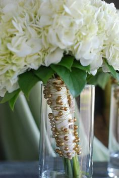 White Hydrangea bridal bouquet with gold pearl stem wrap