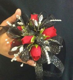Red spray roses with Black,Silver and rhinestone accents.
