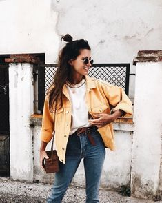 Cute yellow jacket over white tee and blue jeans.