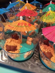 Beginning of summer treat. Vanilla pudding (blue food coloring), Teddy Grahams swimmers, crushed graham crackers for the sand, kids love a cute drink umbrella!