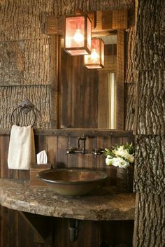 Love this bathroom. Wood, sink, counter, light!