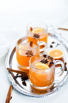 A recipe for mulled white wine, spiced with cloves, star anise, cinnamon, oranges and honey.