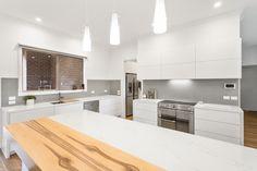 Redheart Sassafrass timber provides beautiful contrast in a white matt Legato kitchen. Timber Kitchen, Custom Cabinets, Cabinet Design, Kitchen Design, Custom Design, Contrast, New Homes, Interiors, Interior Design